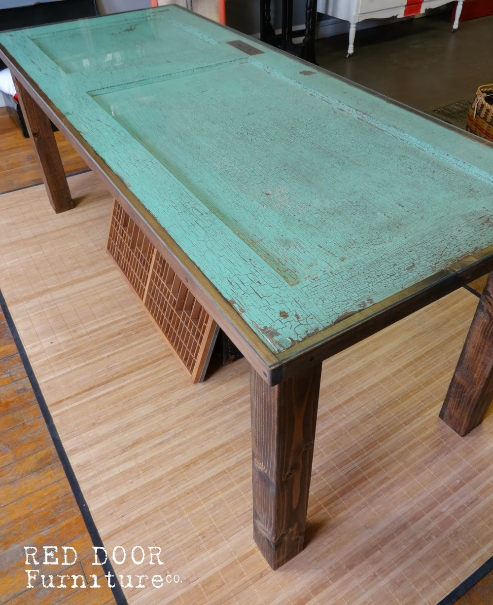 This table has a full sheet of glass to create a level surface. This is also the original paint, so the glass also keeps any potential flakes or chips from coming off.