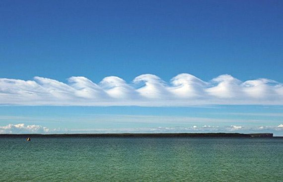 jtotheizzoe :       Kelvin-Helmholtz Instability   manifested in clouds. It happens when two mediums (wind and cloud) meet at different velocities and produce waves. Sort of like blowing across a glass of water.