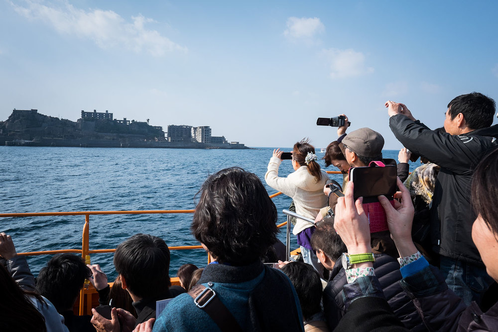 As soon as Gunkanjima was in sight, everyone unloaded the crap outta their cameras.