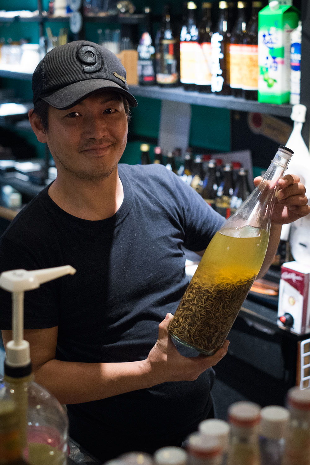 The owner with the maggot liquor bottle