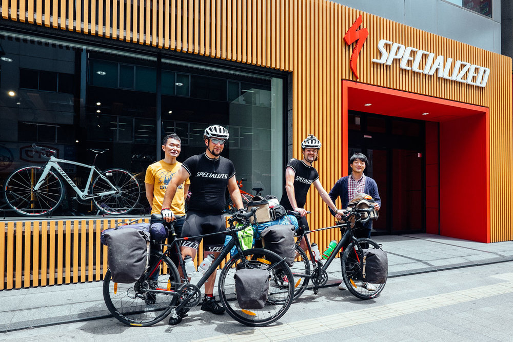 The two of us, our bikes, Kenta and Shuhei, in front of the Specialized HQ Japan