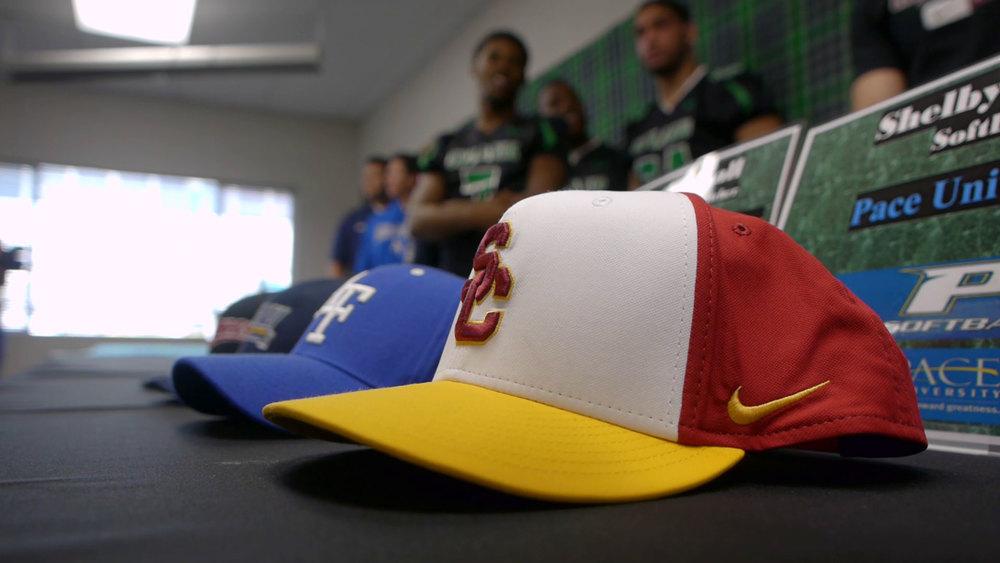 Signing-Day-Presser-Hats.jpg