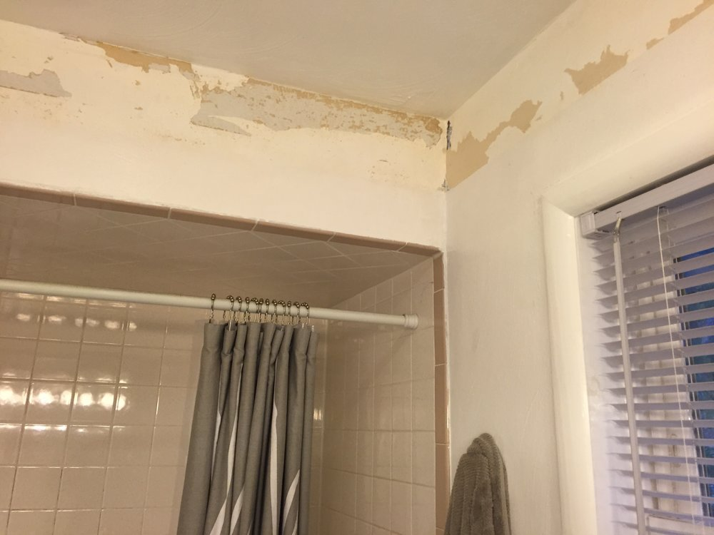 The soffit over the existing shower alcove restricted light coming into the area and gave the shower a cramped feel. Soffits above the vanity and shower were both removed.