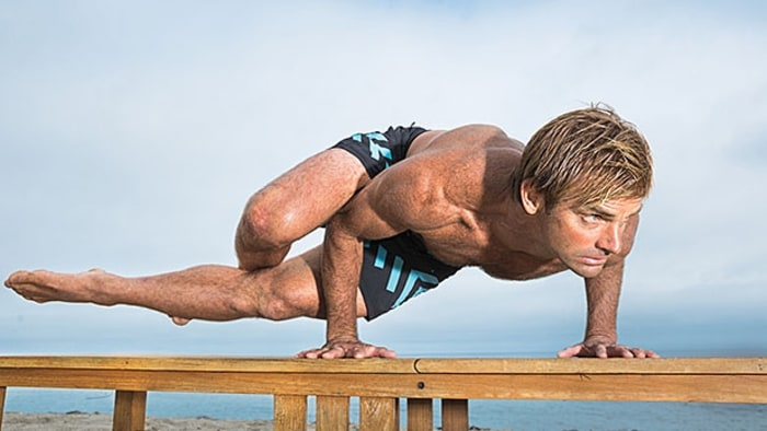 You don't need an hourlong class or superhuman flexibility (like what Laird Hamilton shows off here) to start the day off right. Credit: Photograph by Peter Bohler