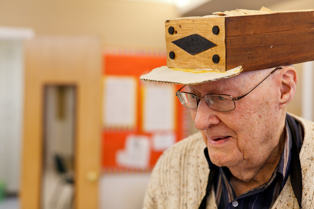 *Rather than don a hair net, Waldo constructed this hat from salvaged wood and cardboard and wears it with pride when he volunteers.