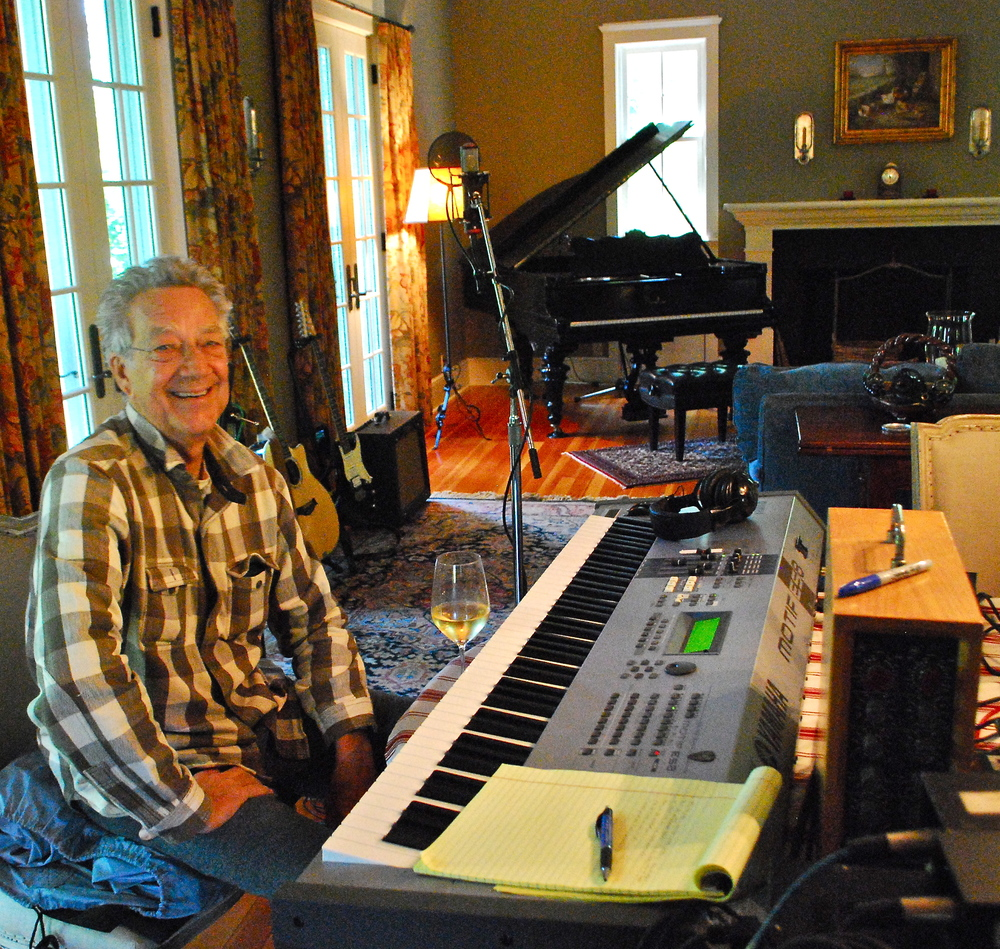 Ray M laughs w glass wine on keys FX.JPG