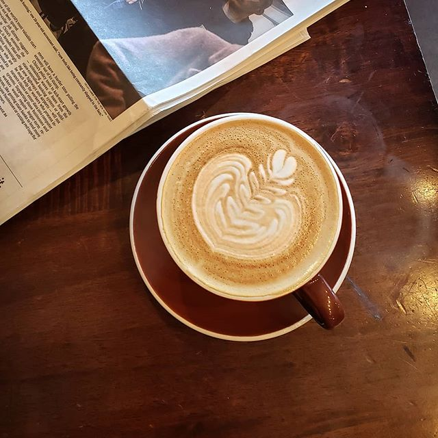 Nothing like enjoying a coffee while reading the newspaper.