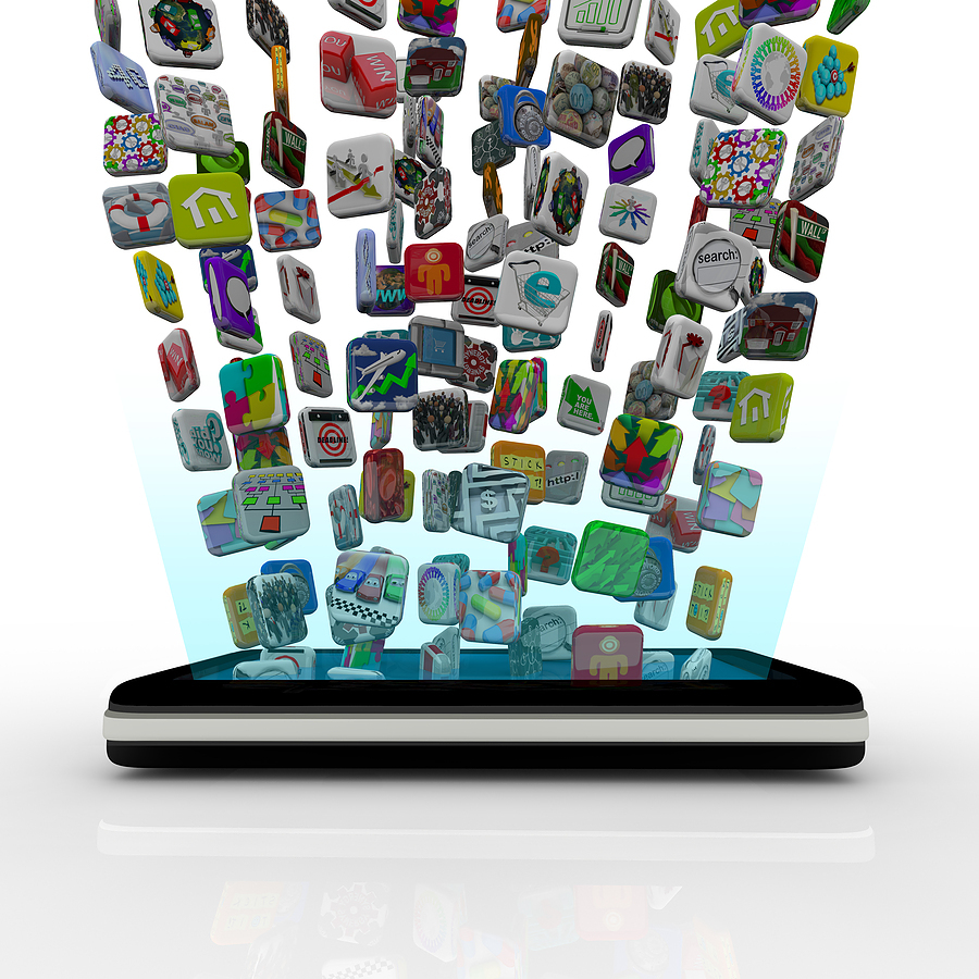 bigstock_App_Icons_Downloading_Into_Sma_12353408.jpg