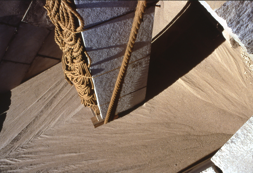 Obelisk on sand flow.jpg