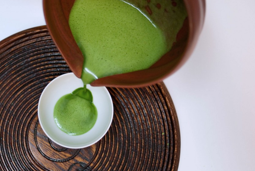 Carefully pour your matcha into a teacup.