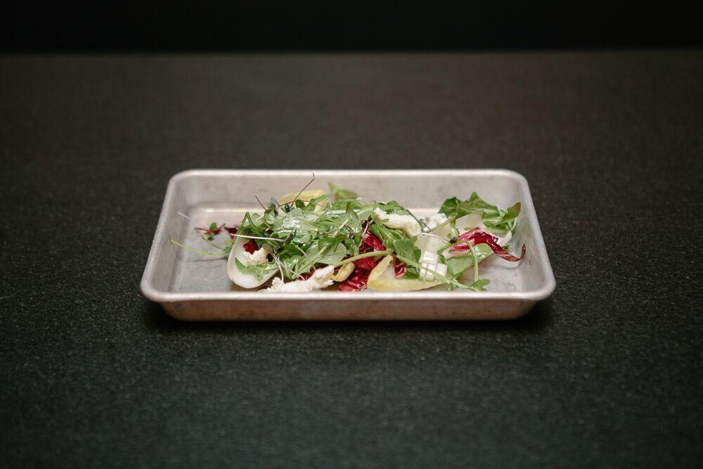 endive. arugula. radicchio. pear. gorgonzola. tarragon vinaigrette