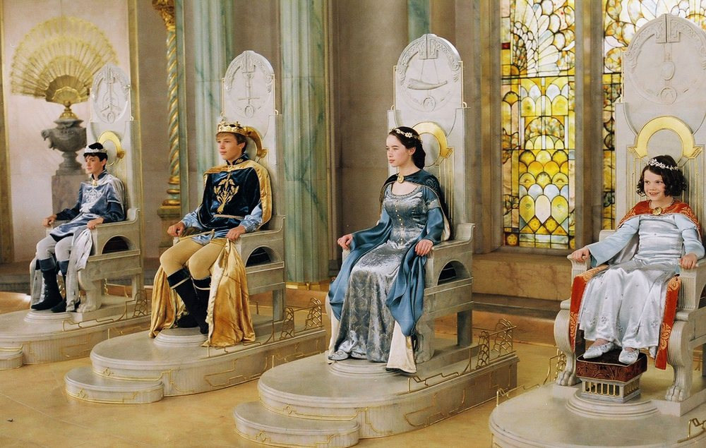 King Edmund, High King Peter, Queen Susan, and Queen Lucy enthroned at Cair Paravel