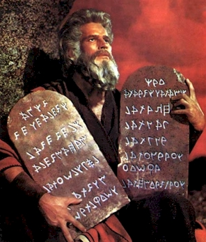 Moses as classically portrayed by Charlton Heston bearing the Ten Commandments a.k.a. the Moral Law of God--which still applies
