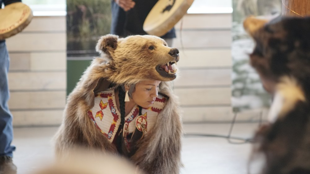 Laura Grizzlypaws with the St'át'imc Bear Dancers.