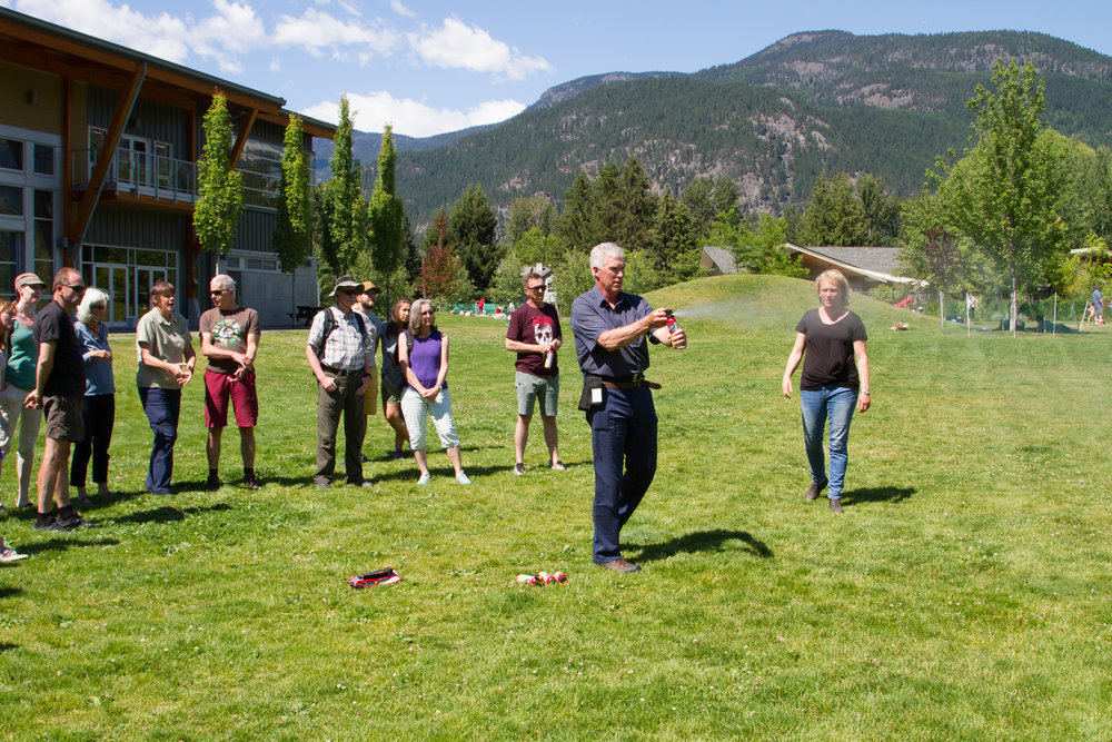 Our Livestock Conflict Prevention Program Coordinator, Allen McEwan, demonstrates proper bear spray use in Pemberton.