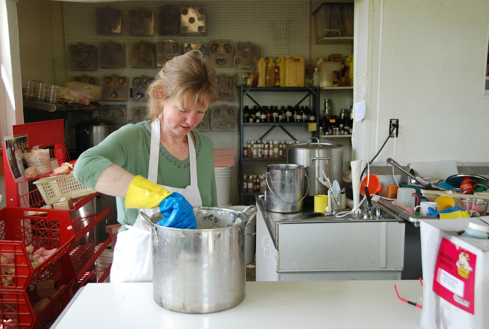 Soap kitchen wide with Dela stirring 1.jpg