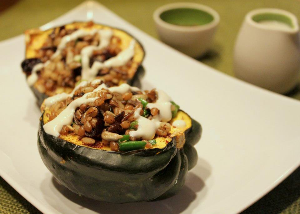 Acorn squash stuffed with barley, wild rice, scallions, dried cherries, za'atar spices and drizzled with tahini
