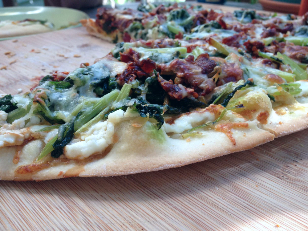 A turnip green and bacon pizza we made from our share last year