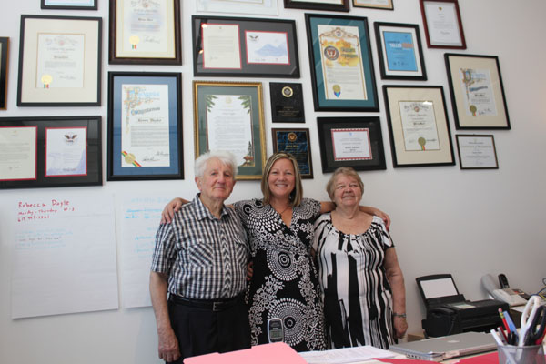 Keren Taylor with her parents in front of WriteGirl Wall of Awards. Photo courtesy Karen Taylor / WriteGirl