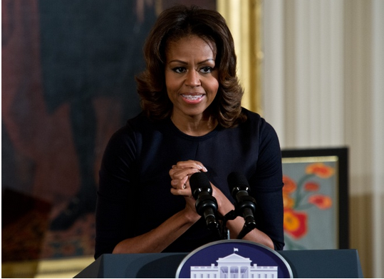 First Lady Michelle Obama speaks at the Presidents Committee on the Arts and the Humanities (PCAH) National Arts and Humanities Youth Program Awards at the White House in Washington on Nov. 22, 2013. (Photo Credits: Nicholas Kamm/AFP/Getty Images)
