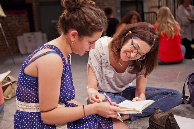 Screenwriter Josann McGibbon (Runaway bride) helps a teen girl write a scene at our screenwriting workshop