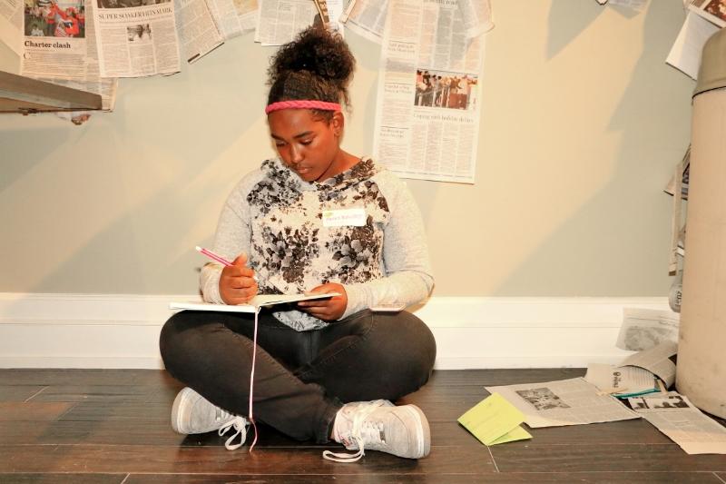 mentee writing in journal on floor.JPG