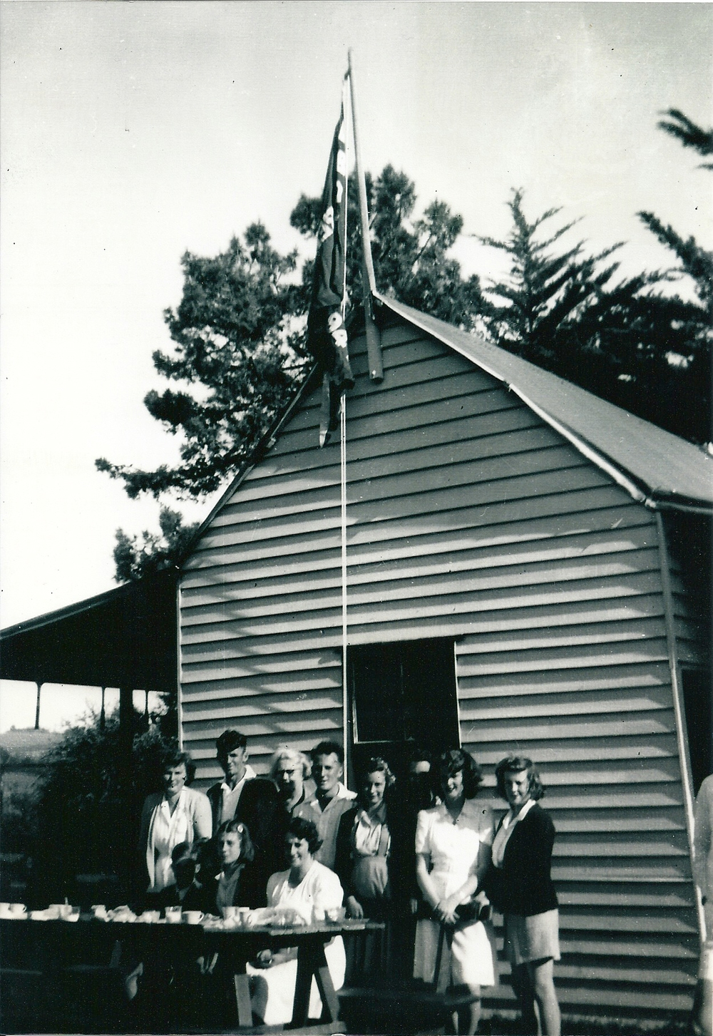 The old pavilion at Narre Warren North Tennis courts about 1949  Standing: Mary Asling, Ray Hart, Alice Randle, Tony Lukies, Merle Ackland, Doff Asling, Pat Asling, Dorothy Harries  Seated at front: Lesley Hart, Bev Ackland, Leila Robinson