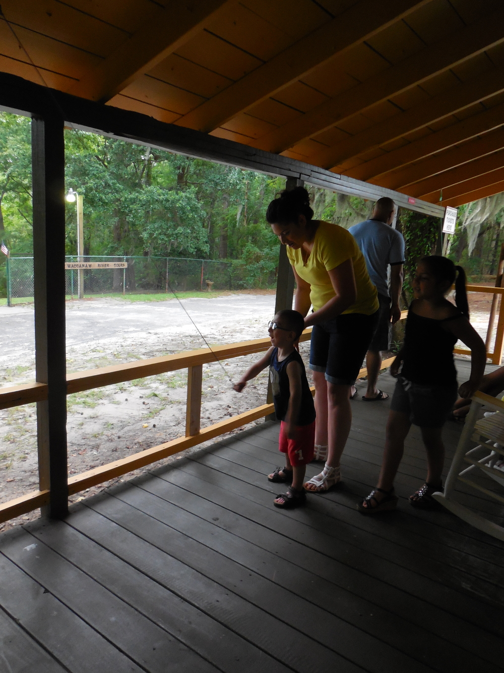 Customers enjoying the swing ring game when checking-in at Waccamaw River Tours.  Plenty of games and things to do before you board for the boat tour.