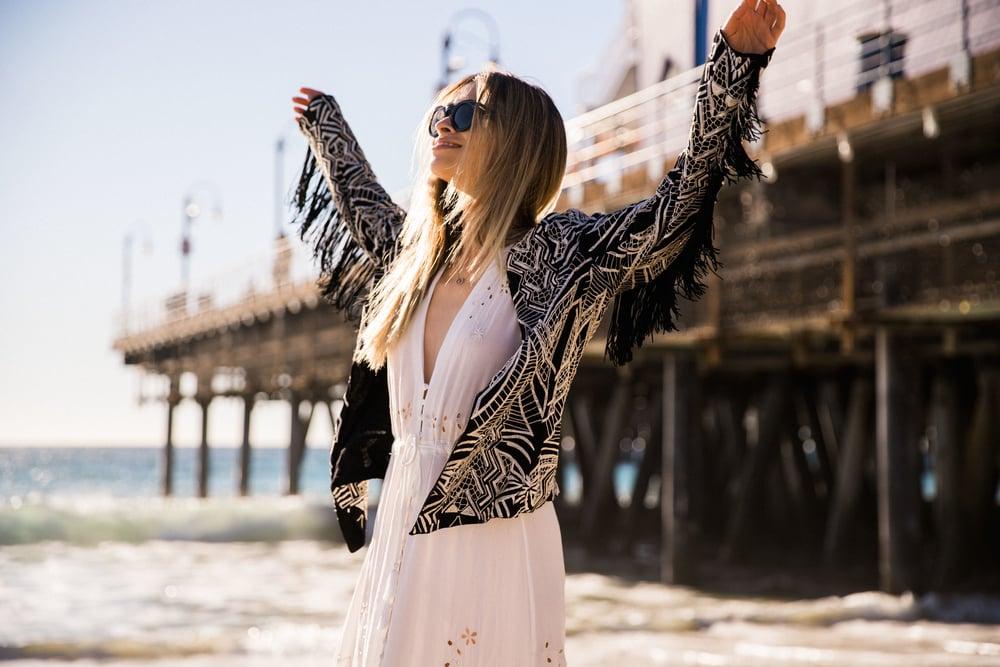 cleobella_fringe_fringe coat_print coat_fringe jacket_santa monica_foray collective_shop by influencer_savvyjavvy_roguefoto_benjamin smith photographer_celine sunglasses_la style_boho chic style_spell and the gypsy collective_barbara bui boots_beach_la fashion blogger