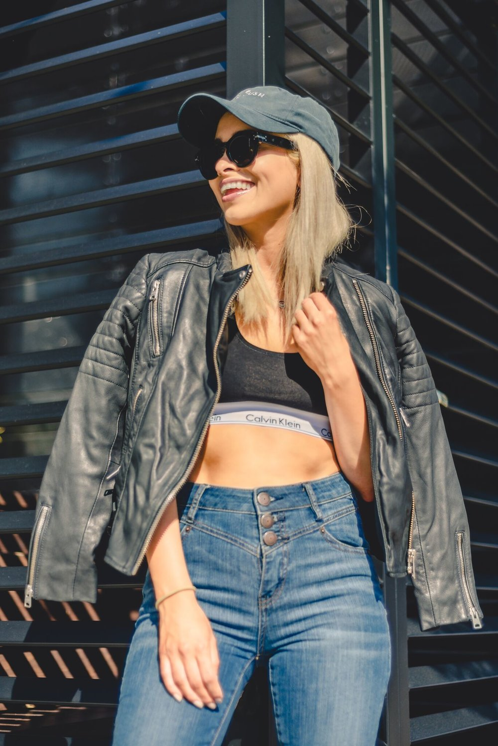 calvin klein sports bra_in my calvins_savvy javvy_la fashion blogger_nyc fashion blogger_converse sneakers_high waisted jeans_celine sunglasses_casual street style_all saints jacket_bcbg_selwyn ramos_fashion blogger_santa monica_la stylist