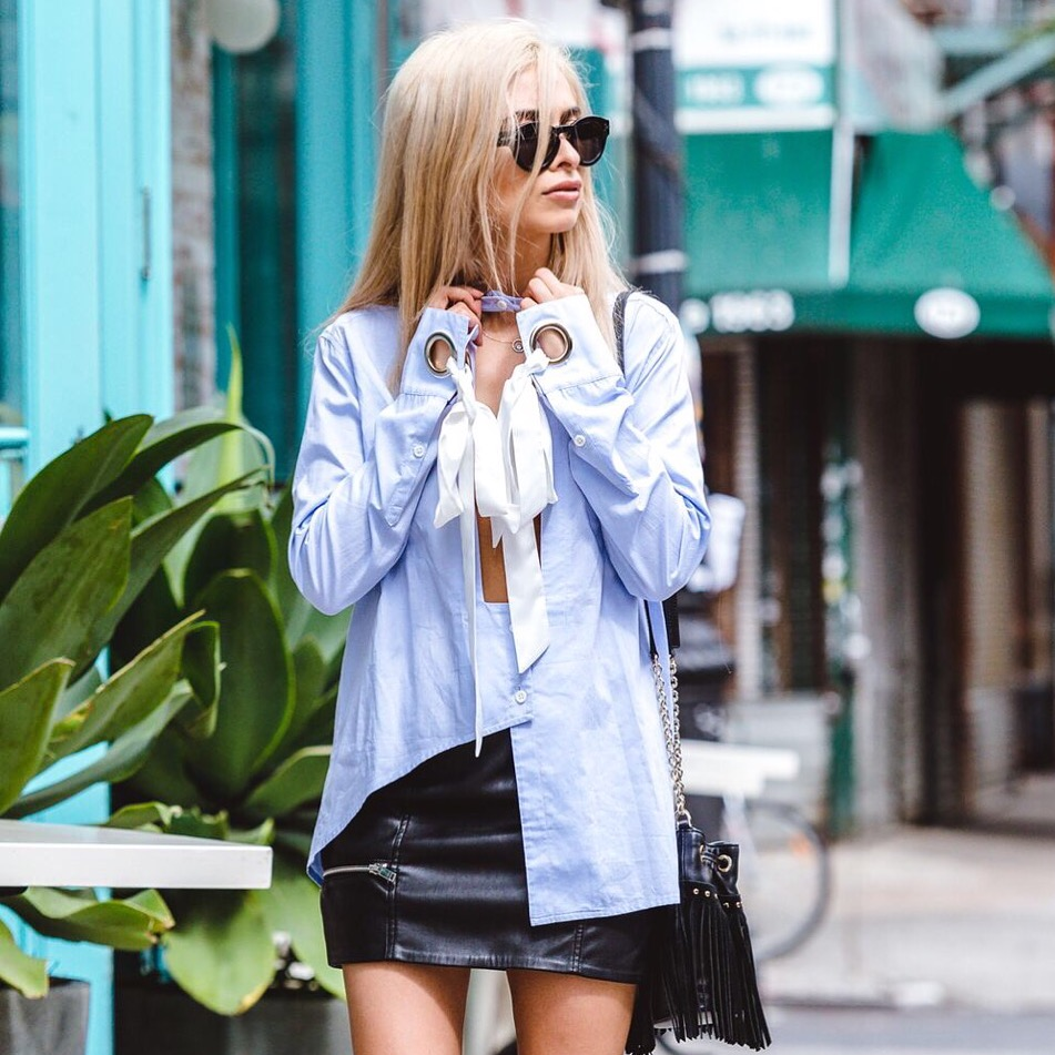 unique blue cut out button up top with bow_leather skirt_gladiator heels_celine sunglasses_iijen_forever 21_fringe bag_NYC fashion blogger