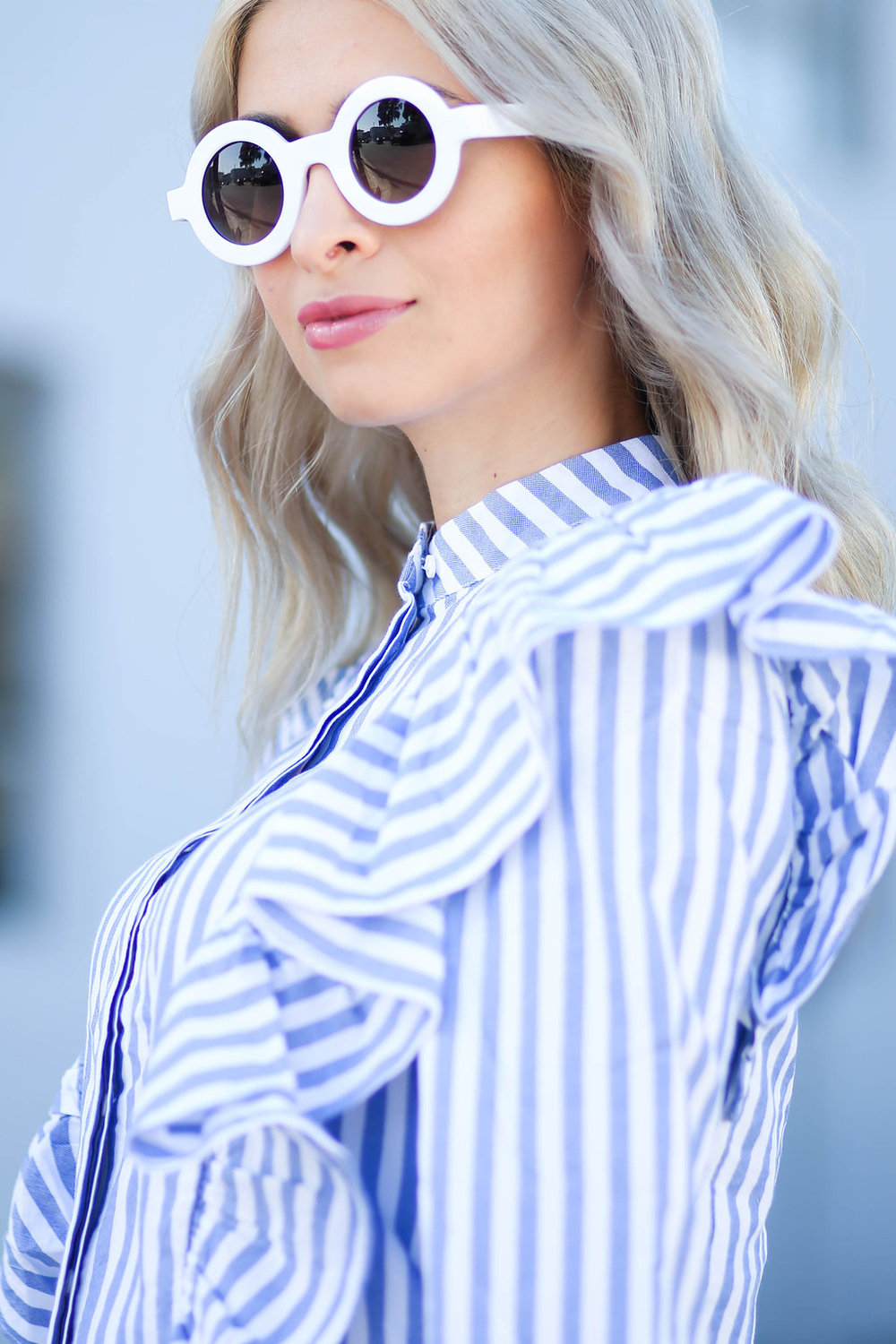 statement blouse_striped button up_striped top_outdress your boss_flared jeans_joes jeans_loefler randall bag_loefler randall wedges_round sunglasses_white sunglasses_statement top