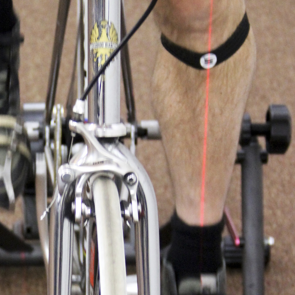 Knee alignment attained through a number of micro adjustments to cleat, pedal, and saddle position.