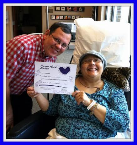Yvonne Barra with her husband and the certificate declaring her cancer-free
