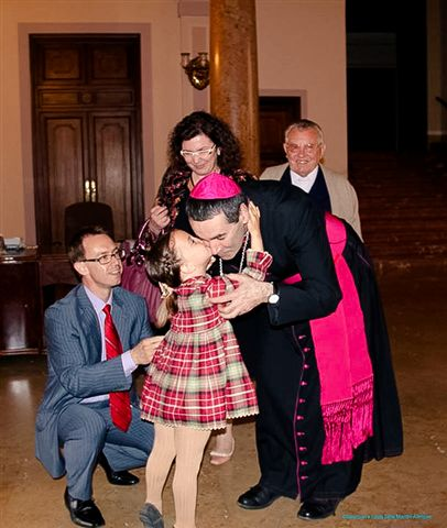 Little Carmen, whose healing was approved as the miracle for the canonization of blessed louis and zelie martin, with her parents and mgr jacques habert, bishop of the diocese of seez in northern france,where louis and zelie spent their married life.  valencia, spain, may 2013.