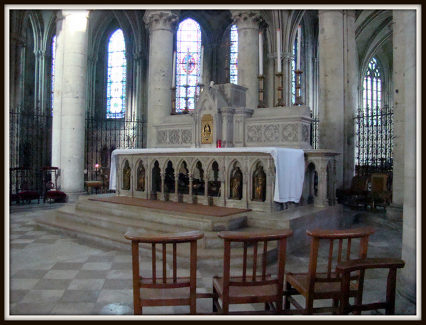 the main altar of st. pierre's cathedral, donated by st. louis martin in december 1888