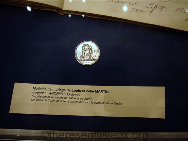 LOUIS AND ZELIE'S ORIGINAL MARRIAGE MEDALLION, NOW IN THE CUSTODY OF THE DIOCESE OF SEES.  PHOTO COURTESY OF SUSAN EHLERT.