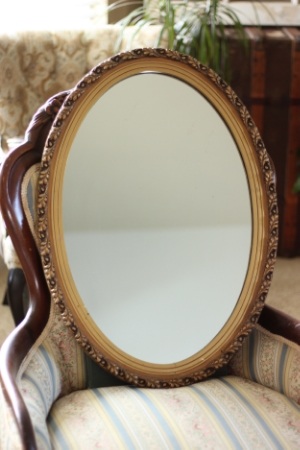 "MED - GOLD-FRAMED, OVAL MIRROR  19"" X 27""  $20"