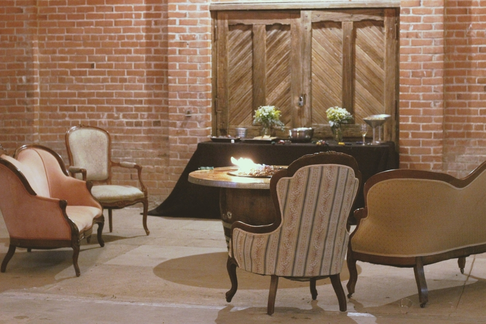 Old Sugar Mill industrial Vintage lounge seating area wine country wedding rentals
