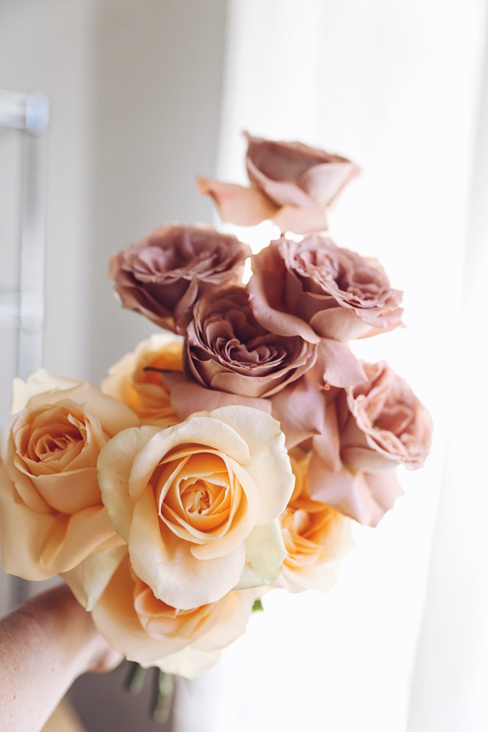 TIP:  In the colder months, I buy most of my flowers earlier in the week for a weekend event to give them more time to open.  If you gently peel back the outer petals of roses, this helps to make them look fuller and more open.