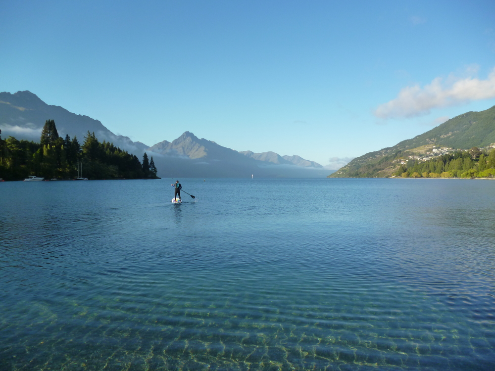 Paul paddleboarding on Lake Wakatipu, Queenstown, NZ photo by Sunstone