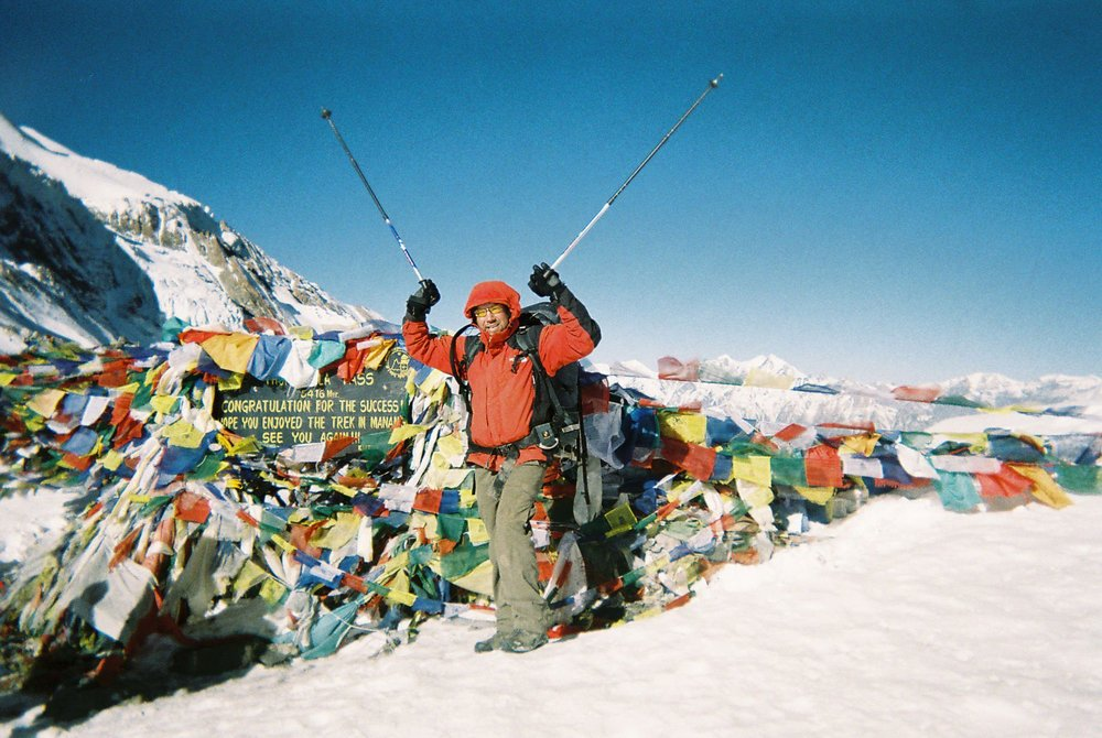Paul crossing the Thorong La Pass at 5,416m the climax point of the Annapurna Circuit Trek in Nepal, the Himalayas