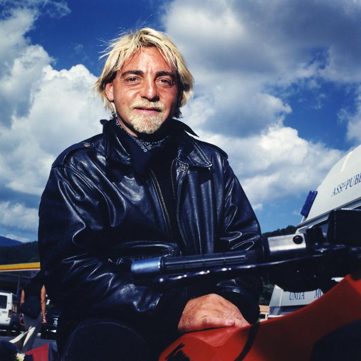 Italian motorbiker.   Area di servizio Magra Ovest, autostrada A12 Genova-Roma .   August 2001