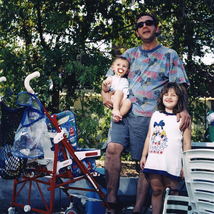 Italian family during snacktime.   Area di servizio Nure Est, autostrada A21 Torino-Brescia .   August 2001