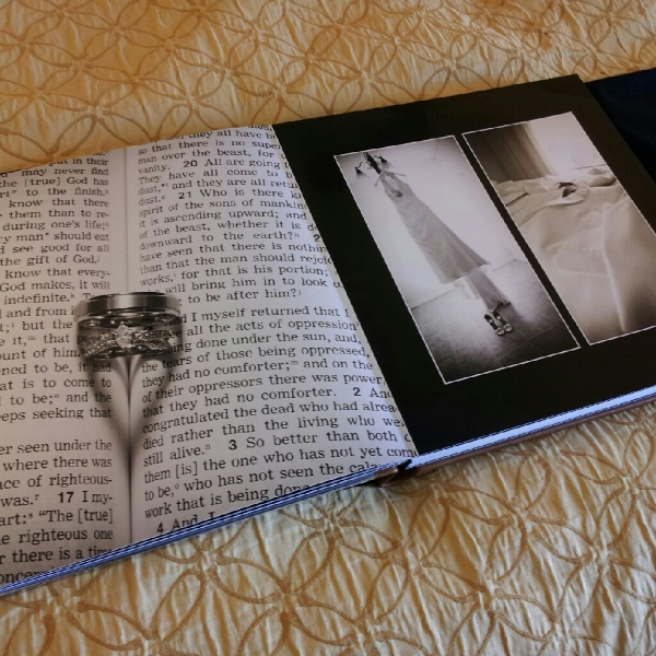 A 12x12 wedding album opened up gives 2 feet of viewing area to have an almost larger than life memory.