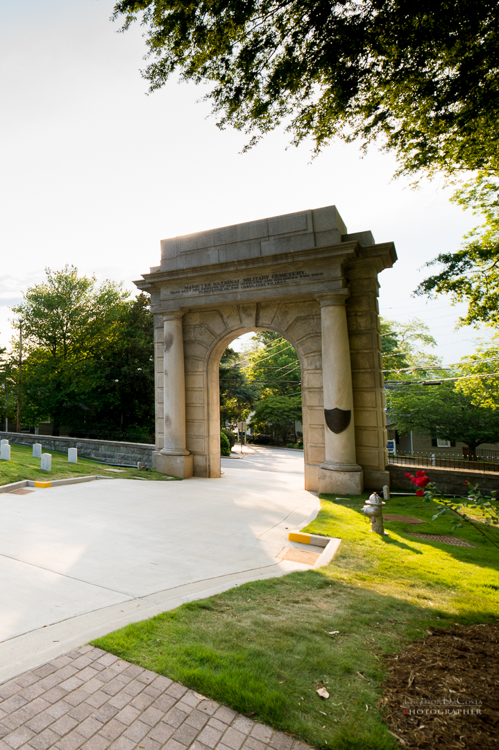 "A granite memorial arch at the cemetery gate is inscribed: ""Here rest the remains of 10,312 Officers and Soldiers who died in defense of the Union 1861-1865."""