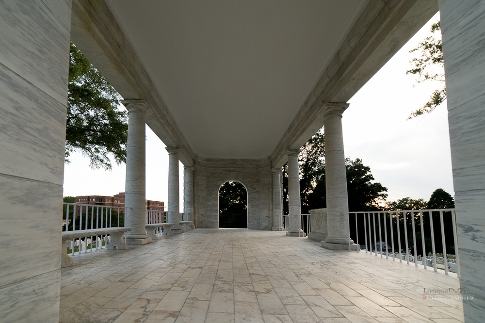 The white marble and concrete rostrum, 37 feet by 22 feet, with a metal roof was constructed in April 1940. The structure is of a classic architectural design and resembles a Greek temple of the Acropolis.