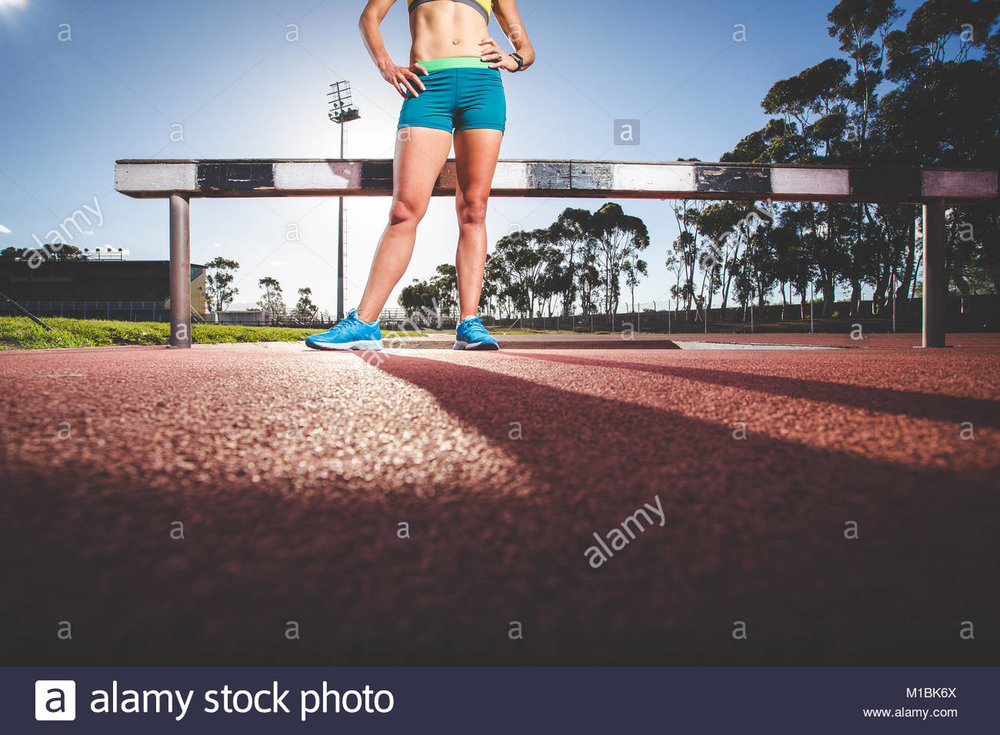 female-fitness-model-and-track-athlete-sprinting-on-an-athletics-track-M1BK6X.jpg