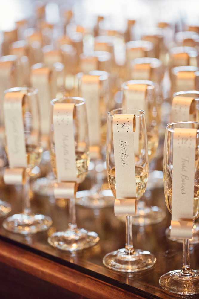 champagne flutes as escort cards