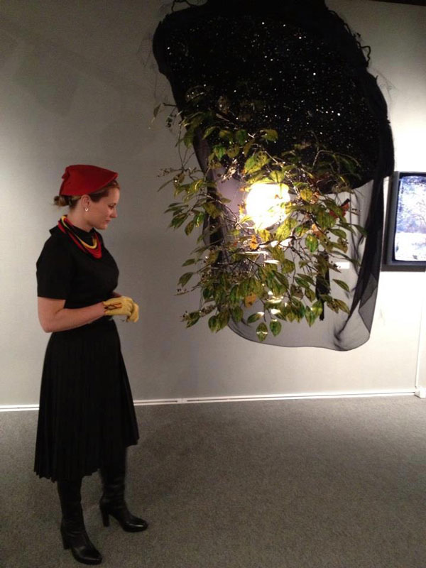 Kelly Heaton viewing   Electrolier (Summer Night)   at the ADAA Art Show 2013. Private collection